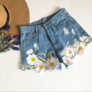 Vintage high rise distressed floral jean shorts
